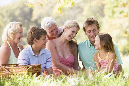 Family at a picnic smiling photo