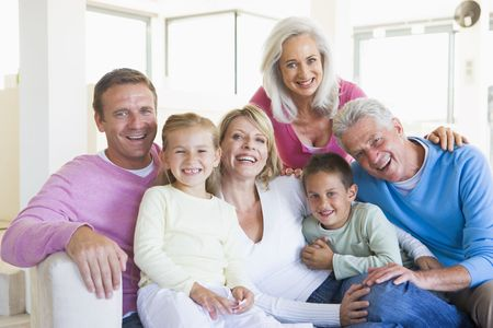 Family sitting indoors smiling photo