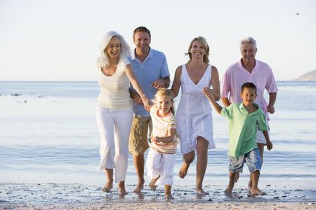 a generation: Extended family walking on beach