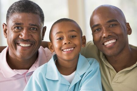 a generation: Grandfather with adult son and grandson Stock Photo