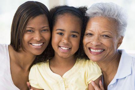 grandmother children: Abuela con adultos hija y nieto  Foto de archivo