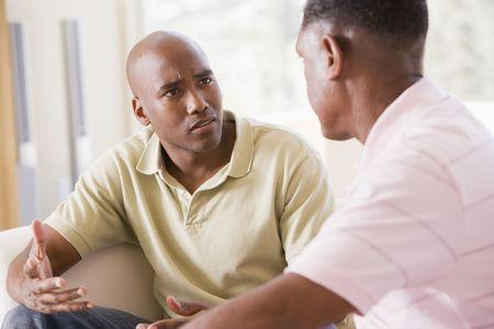 disagreeing: Two men in living room talking