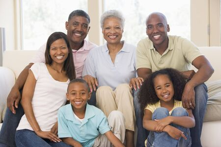 Extended family in living room smiling photo