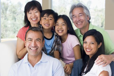 Extended family in living room smiling Stock Photo - 3460316
