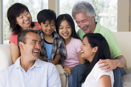 filipino people: Extended family in living room smiling