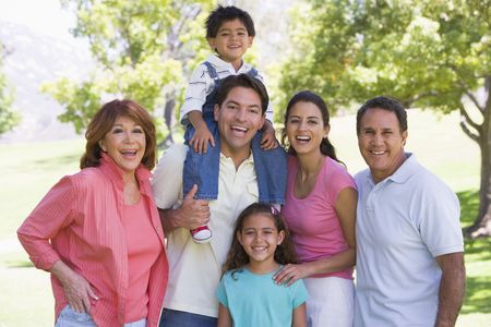 Extended family standing outdoors smiling Stock Photo - 3460381