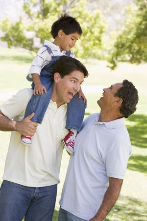 shoulder ride: Grandfather with adult son and grandchild