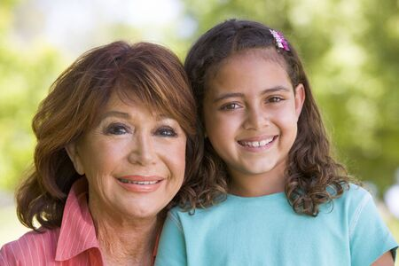 Grandmother and granddaughter smiling Stock Photo - 3460462
