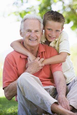 grandsons: Grandfather and grandson smiling. Stock Photo