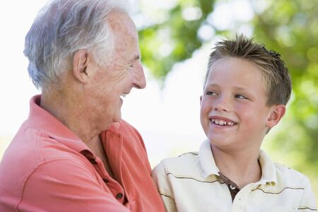 Grandfather and grandson smiling outdoors. Stock Photo - 3460102