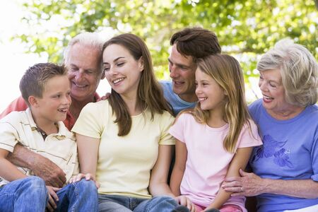 Extended family outdoors smiling Stock Photo - 3460455