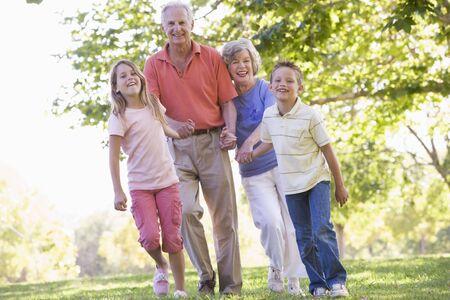 Grandparents walking with grandchildren. photo