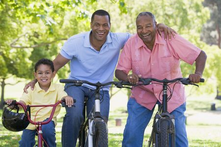sons and grandsons: Grandfather grandson and son bike riding.