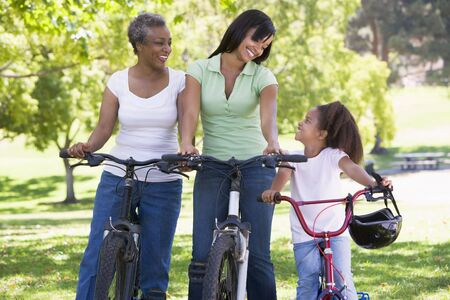 Grandmother mother and granddaughter bike riding. photo