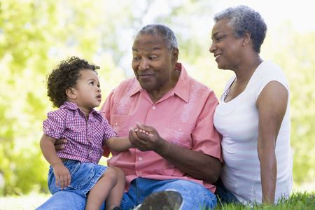 Grandparents with grandson in park photo