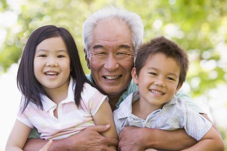 japanese family: Grandfather posing with grandchildren.