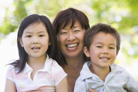 grandkids: Grandmother laughing with grandchildren. Stock Photo