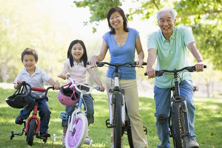 Grandparents bike riding with grandchildren. photo