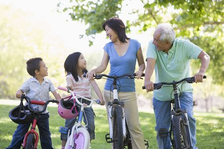 Grandparents bike riding with grandchildren. Stock Photo - 3460343