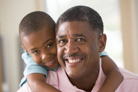 Grandfather and grandson smiling Stock Photo - 3460186