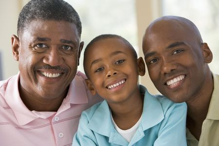 Grandfather with adult son and grandchild photo