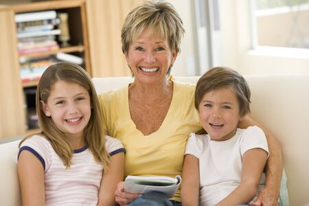 Grandmother reading with grandchildren. photo