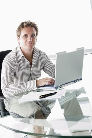 early thirties: Businessman in boardroom with laptop
