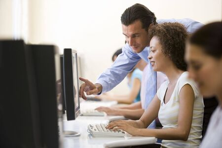 generation x: Man assisting woman in computer room