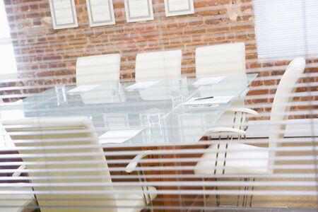 Empty boardroom through a window photo