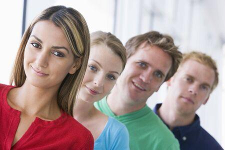 четыре человека: Four people standing in corridor smiling