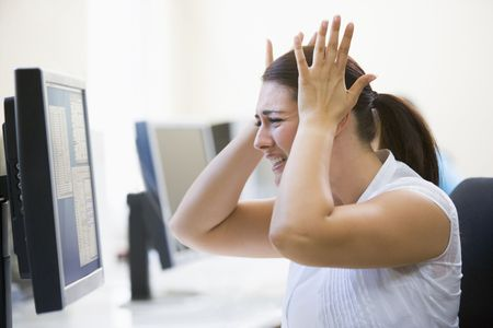 generation x: Woman in computer room looking frustrated