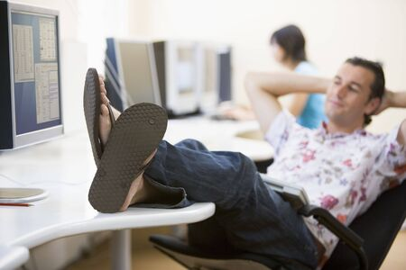 Man in computer room with feet up relaxing Stock Photo - 3460732