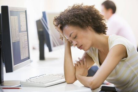 demotivated: Woman in computer room sleeping