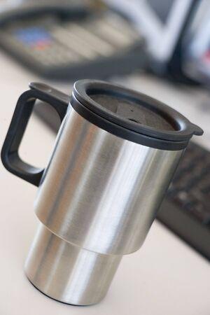 reusable: Shot of a reusable coffee cup on a desk