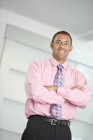 Businessman standing indoors smiling photo
