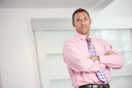 Businessman standing indoors photo