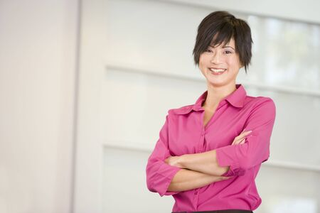 Businesswoman standing indoors smiling photo