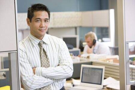 open plan office: Businessman standing in cubicle Stock Photo