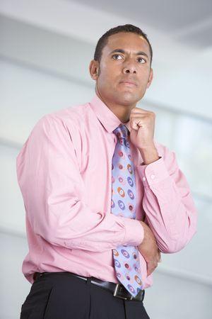 Businessman standing indoors photo