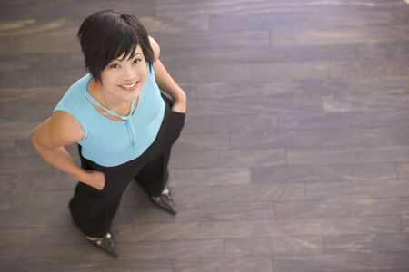 Businesswoman standing indoors smiling photo