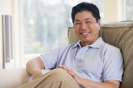 Man sitting in living room smiling photo