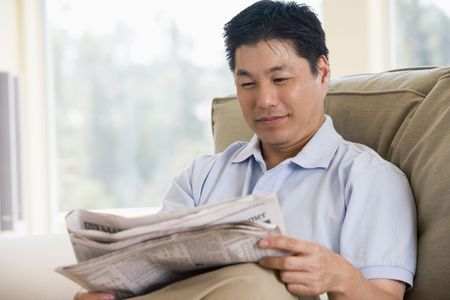 Man relaxing with a newspaper Stock Photo - 3458988