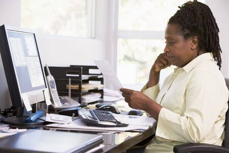 Woman in home office using computer Stock Photo - 3460872
