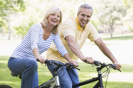 Couple on bikes outdoors smiling Stock Photo - 3471021
