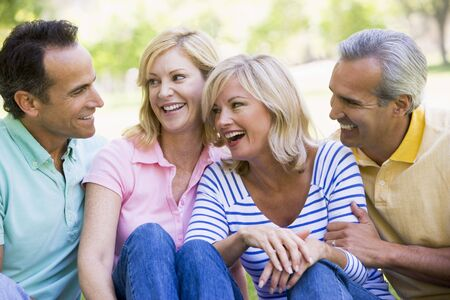 Two couples outdoors smiling photo