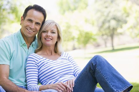Couple relaxing outdoors in park smiling Stock Photo - 3461257