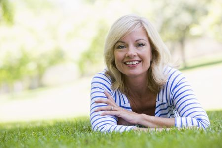 Woman relaxing outdoors smiling photo