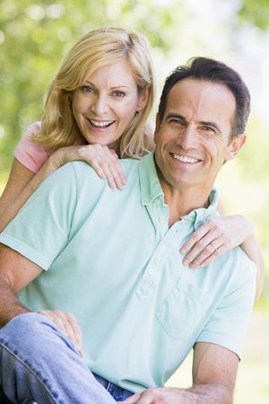 countryside loving: Couple outdoors smiling