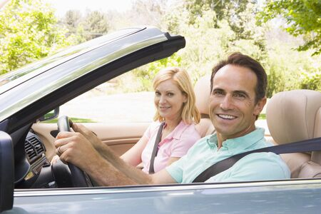 Couple in convertible car smiling Stock Photo - 3472547