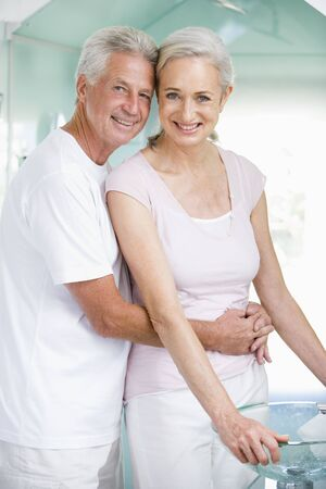 nightclothes: Couple embracing at a spa and smiling Stock Photo